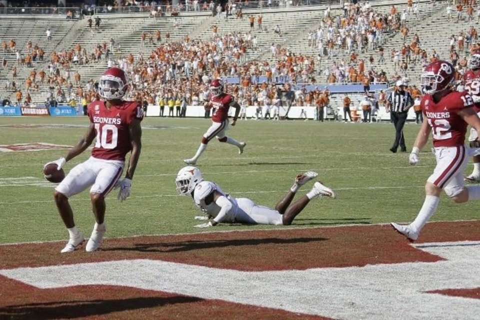 Photo -  OU receiver Theo Wease, left, leaves Texas cornerback Jalen Green, center, in the dust on a two-point conversion. It's similar to how the Sooners have left the Longhorns in the win-loss column over the past decade, even as the two programs have had similar recruiting success. [BRYAN TERRY/THE OKLAHOMAN]