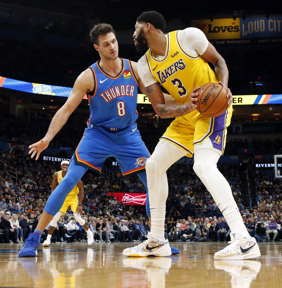 Photo - Oklahoma City's Danilo Gallinari (8) defends Los Angeles' Anthony Davis (3) in the third quarter during an NBA basketball game between the Oklahoma City Thunder and the Los Angeles Lakers at Chesapeake Energy Arena in Oklahoma City, Friday, Nov. 22, 2019. The Lakers won 130-127. [Nate Billings/The Oklahoman]