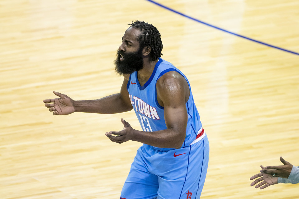 Photo - Houston Rockets guard James Harden (13) reacts to a call during the team's NBA basketball game against the Los Angeles Lakers on Tuesday, Jan. 12, 2021, in Houston. (Mark Mulligan/Houston Chronicle via AP)