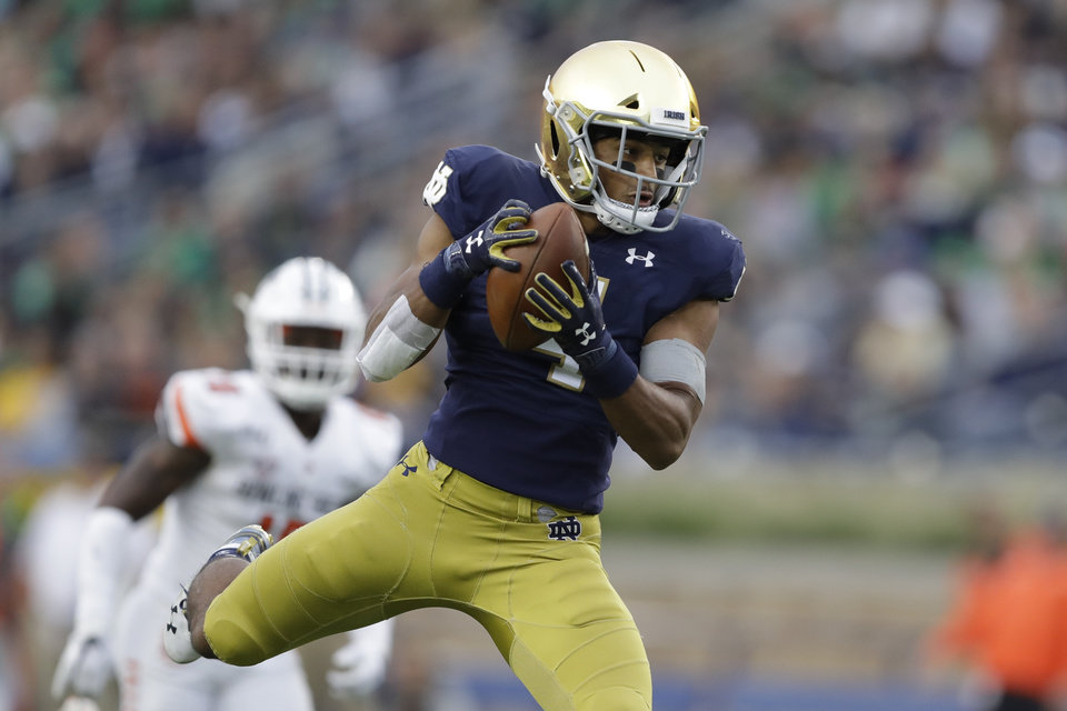 Photo -  Notre Dame running back Avery Davis (4) makes a catch during the second half of an NCAA college football game against Bowling Green, Saturday, Oct. 5, 2019, in South Bend, Ind. Notre Dame won 52-0. [AP Photo/Darron Cummings]