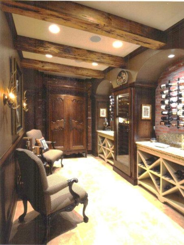 Photo - A wine room can be a quiet place or a space for entertaining. Photo provided by A Karen Black Co.