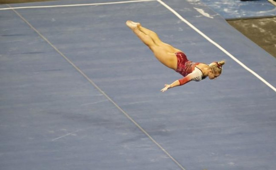 Photo -  OU's Ragan Smith performs in the floor routine Sunday in Norman. [Sarah Phipps/The Oklahoman]