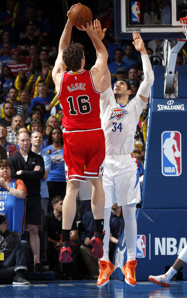 Photo - Oklahoma City's Enes Kanter (34) defends as Chicago's Pau Gasol (16) shoots the ball during the NBA game between the Oklahoma City Thunder and the Chicago Bulls at Chesapeake Energy Arena in Oklahoma City, Sunday, March  15, 2015. Photo by Sarah Phipps, The Oklahoman