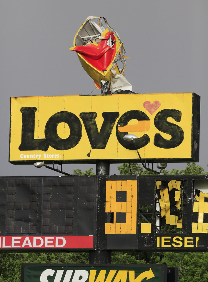 Photo - LOVE'S TRAVEL STOP / STORM DAMAGE / I-40: A tornado's damage can be seen in the large sign above the Love's store south of Interstate 40 at Choctaw Road, Monday evening, May 10, 2010.   Photo by Jim Beckel, The Oklahoman ORG XMIT: KOD