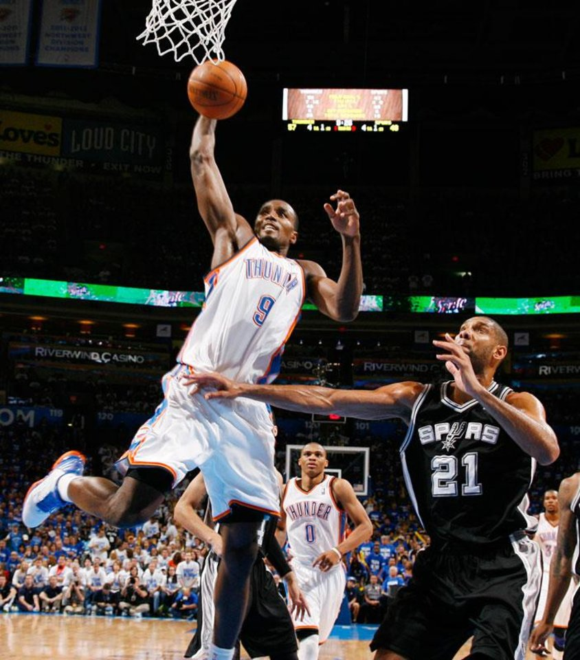 Photo -  Oklahoma City's Serge Ibaka (9) dunks against San Antonio's Tim Duncan (21) in the second half during Game 4 of the Western Conference Finals between the Oklahoma City Thunder and the San Antonio Spurs in the NBA playoffs at the Chesapeake Energy Arena in Oklahoma City, Saturday, June 2, 2012. Oklahoma City won, 109-103. Photo by Nate Billings, The Oklahoman