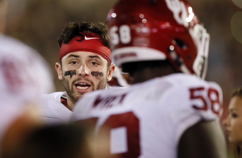 Photo - Oklahoma's Baker Mayfield (6) speaks to his teammates during a college football game between the University of Oklahoma Sooners (OU) and Texas Tech Red Raiders at Jones AT&T Stadium in Lubbock, Texas, Saturday, Oct. 22, 2016. OU won 66-59. Photo by Nate Billings, The Oklahoman