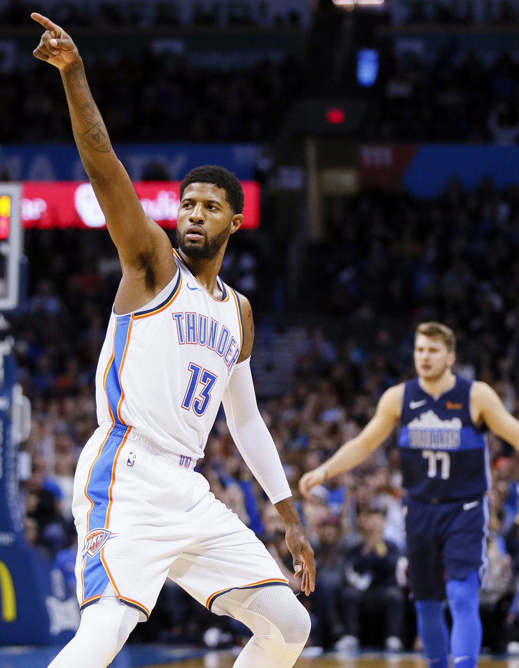 Photo - Oklahoma City's Paul George (13) points after making a three-point-shot during an NBA basketball game between the Oklahoma City Thunder and Dallas Mavericks at Chesapeake Energy Arena in Oklahoma City, Monday, Dec. 31, 2018. Photo by Nate Billings, The Oklahoman