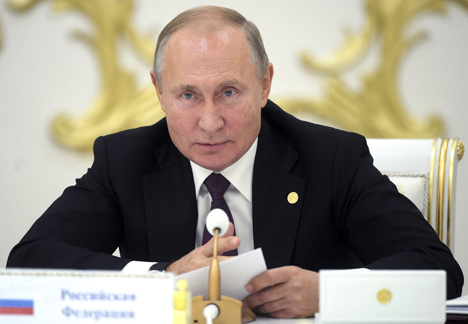 Photo -  Russian President Vladimir Putin speaks at the Summit of leaders from the Commonwealth of Independent States (CIS) in Ashgabat, Turkmenistan, Friday, Oct. 11, 2019. (Alexei Druzhinin, Sputnik, Kremlin Pool Photo via AP)