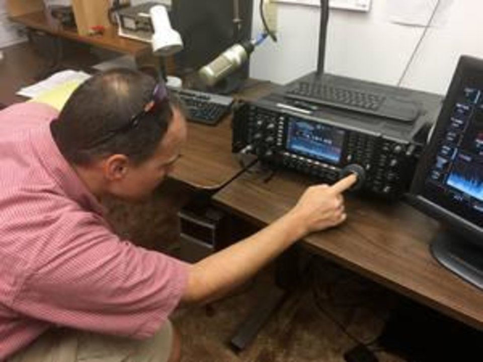 Photo -  Marcus Sutliff, 46, of Edmond, demonstrates how to operate radio equipment at the Edmond Downtown Community Center. [PHOTO BY NICK SARDIS, THE OKLAHOMAN]