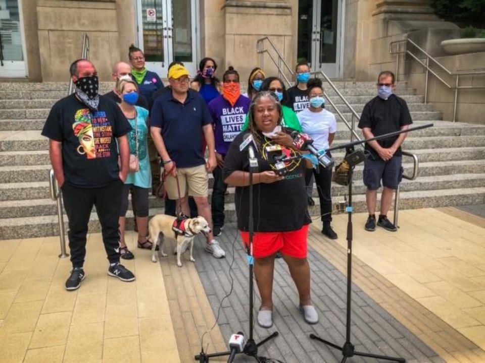 Photo -  A Black Lives Matter OKC news conference on Monday was led by Executive Director the Rev. T. Sheri Dickerson. The group issued a list of demands to the mayor, police chief and governor. [Dave Morris/The Oklahoman]