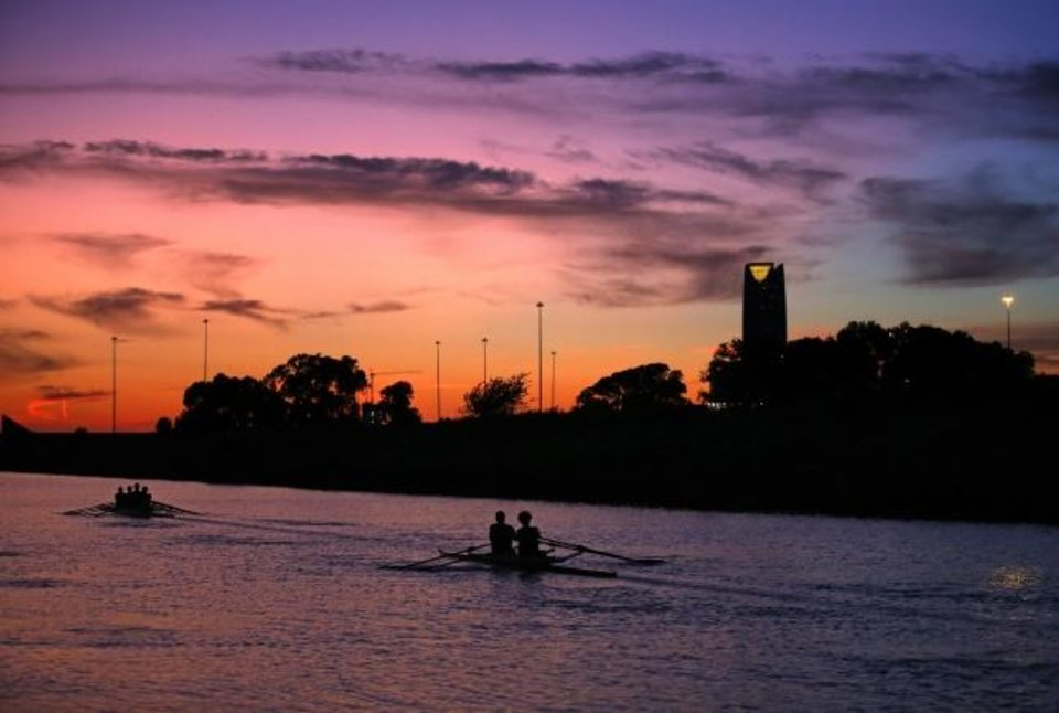 Photo -  Rowers practice as the sunsets on the Oklahoma river in Oklahoma City, Tuesday, Sept. 24, 2019. [Sarah Phipps/The Oklahoman]
