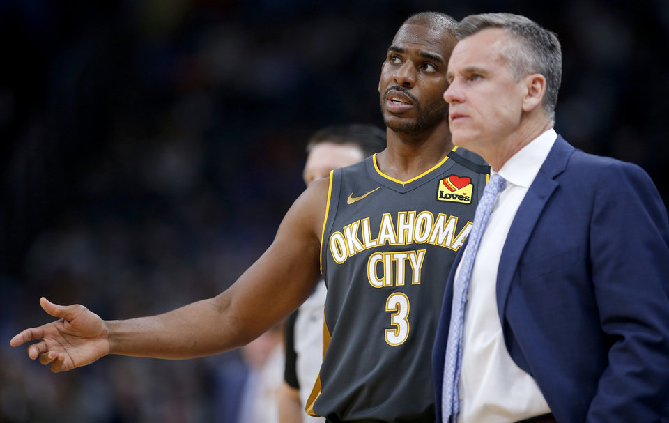 Photo - Oklahoma City's Chris Paul (3) talk with Billy Donovan during the NBA basketball game between the Oklahoma City Thunder and the Denver Nuggets at the Chesapeake Energy Arena in Oklahoma City,  Friday, Feb. 21, 2020.  [Sarah Phipps/The Oklahoman]