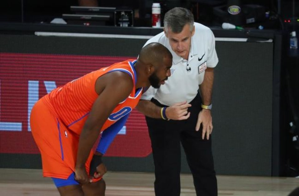 Photo -  Thunder coach Billy Donovan talks to guard Chris Paul (3) in the first half against the Houston Rockets in Game 1 of their playoff series on Aug. 18. [Kim Klement/USA TODAY Sports]