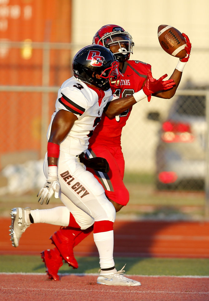 Photo - Carl Albert's Rico Windham catches a touchdown pass as Del City's LJ Brown defends during the high school football game between Carl Albert and Del City at Carl Albert High School in Midwest City, Okla., Friday, Sept. 13, 2019. [Sarah Phipps/The Oklahoman]