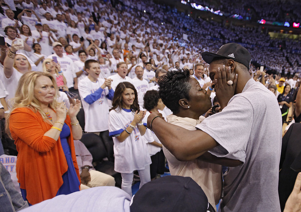 Photo - Kevin Durant talks to his mom Wanda Pratt after the 107-99 win over San Antonio during Game 6 of the Western Conference Finals between the Oklahoma City Thunder and the San Antonio Spurs in the NBA playoffs at the Chesapeake Energy Arena in Oklahoma City, Wednesday, June 6, 2012. Photo by Chris Landsberger, The Oklahoman
