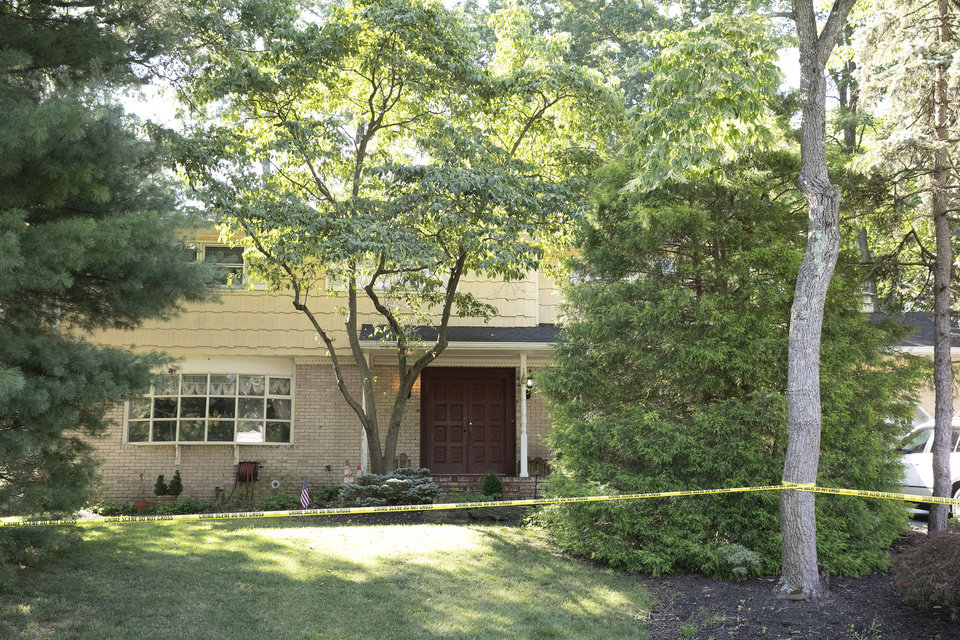 Photo -  Crime scene tape surrounds the home of U.S. District Judge Esther Salas on Monday in North Brunswick, N.J. [Mark Lennihan/The Associated PRess]