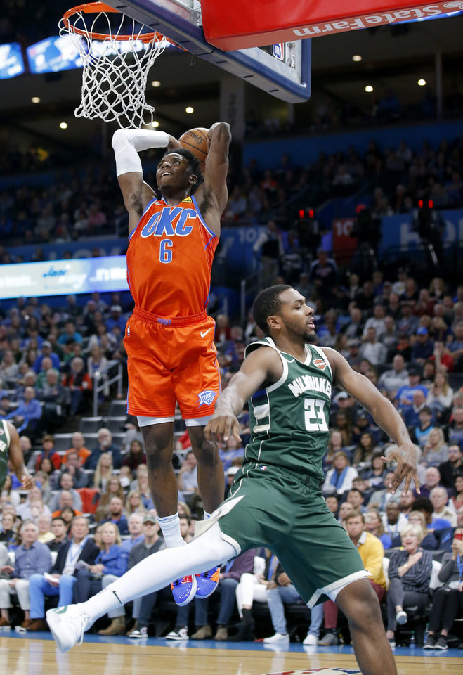 Photo - Oklahoma City's Hamidou Diallo (6) goes up for a basket in front of Milwaukee's Sterling Brown (23) during the NBA game between the Oklahoma City Thunder and the Milwaukee Bucks at Chesapeake Energy Arena,   Sunday, Nov. 10, 2019.  [Sarah Phipps/The Oklahoman]