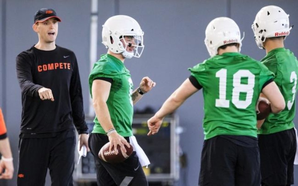 Photo -  Oklahoma State's new offensive coordinator, Sean Gleeson, has brought some different wrinkles to coaching the Cowboy quarterbacks. [CHRIS LANDSBERGER/THE OKLAHOMAN]