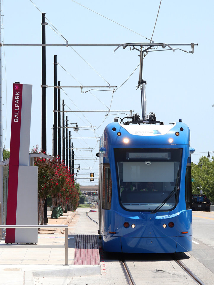 Photo -  A streetcar travels west on Reno in Bricktown on Thursday.