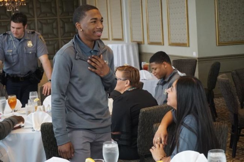 Photo -  Diondre Alexander and Isabella Garcia talk in downtown Oklahoma City's Petroleum Club after convincing local business owners to pledge thousands of dollars for a nonprofit. [Josh Wallace/The Oklahoman]