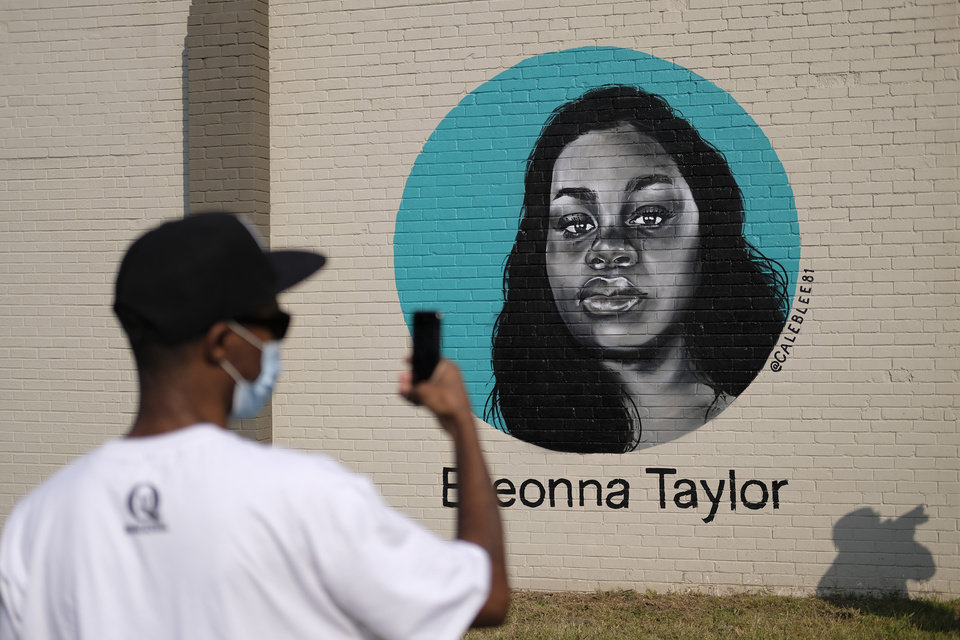 Photo - Celebration of With Love, an Eastside Public Art Project, where six local black artists painted murals on the side of The Market building at 1708 NE 23rd St. and included music and food Saturday, October 3, 2020. [Doug Hoke/The Oklahoman]