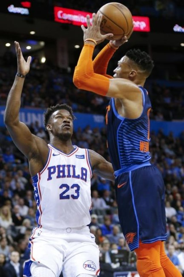 Photo -  Jimmy Butler, left, and Russell Westbrook might be playing together this season for Miami if trade talks continue between the Heat and Oklahoma City Thunder. For now, Miami is unwilling to give up some of its top prospects. [Nate Billings, The Oklahoman]
