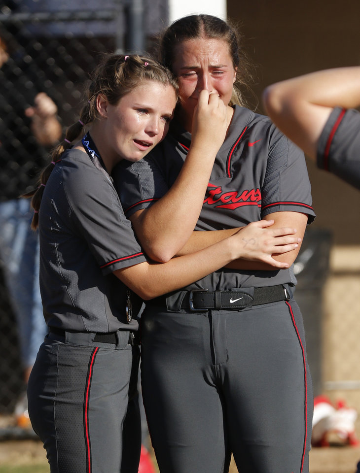 Photo - CAHS #3 Rhiannon Lenz hugs #21 Hannah Williams during the 5A Fast Pitch Championship game between Piedmont and Carl Albert at the Ball Fields at Firelake in Shawnee, Saturday, October 19, 2019. [Doug Hoke/The Oklahoman]