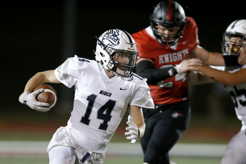 Photo - Minco's Parker Winters carries the ball during a high school football game between Crossings Christian and Minco in Oklahoma City, Friday, Sept. 13, 2019. [Bryan Terry/The Oklahoman]