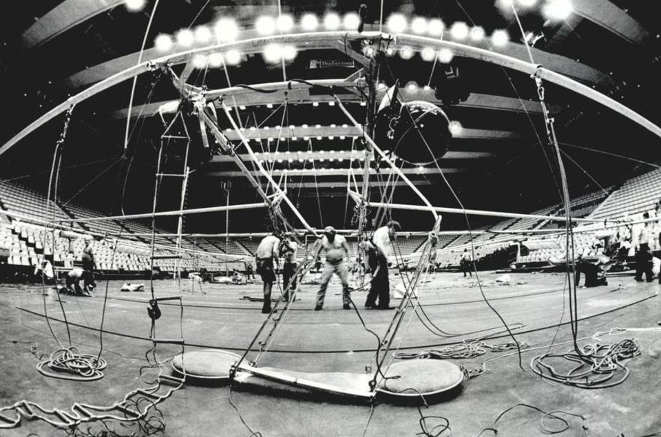 Photo - June 23, 1983: Workers prepare overhead rigging for one of three rings to be featured in the Ringling Bros. and Barnum & Bailey Circus. [Photo by Roger Klock, The Oklahoman Archives]