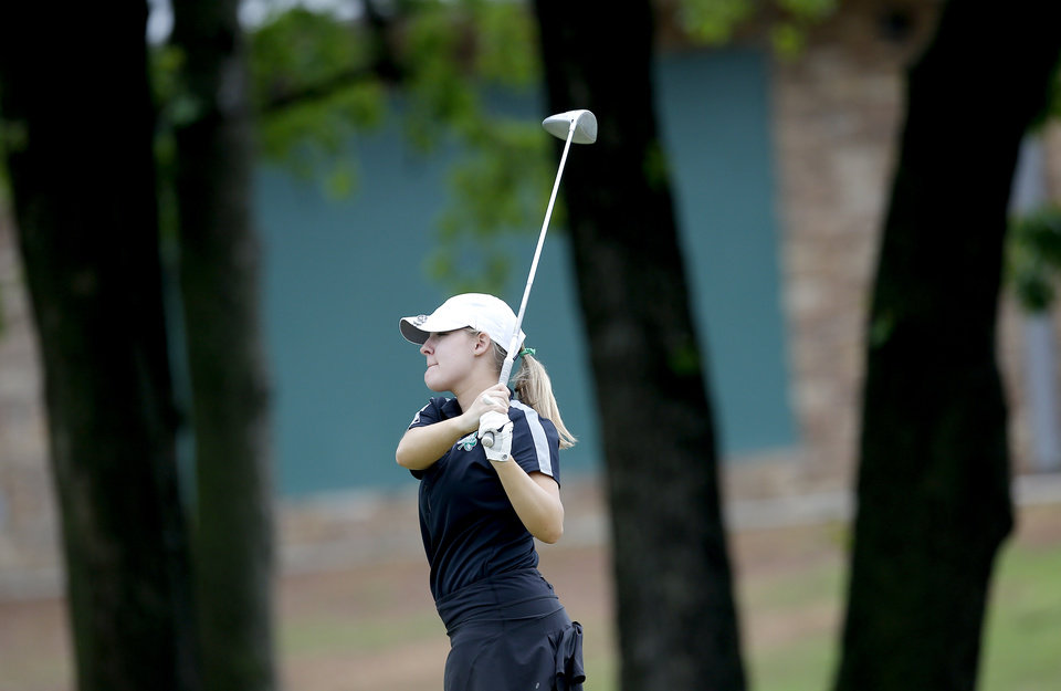 Photo - McGuinness' Emma Mossauer watches her drive on the 17th hole during the 5A girls golf state tournament at Lincoln Park West in Oklahoma City, Wednesday, May 1, 2019. [Sarah Phipps/The Oklahoman]