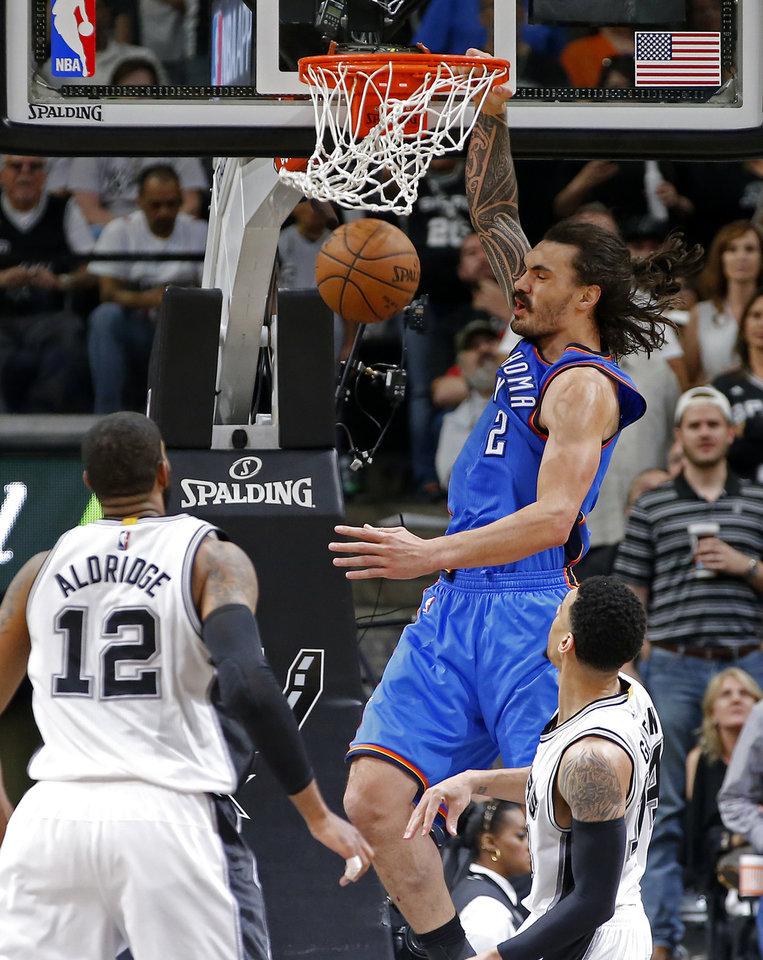 Photo - Oklahoma City's Steven Adams (12) dunks the ball during Game 5 of the second-round series between the Oklahoma City Thunder and the San Antonio Spurs in the NBA playoffs at the AT&T Center in San Antonio, Tuesday, May 10, 2016. Oklahoma City won 95-91. Photo by Bryan Terry, The Oklahoman