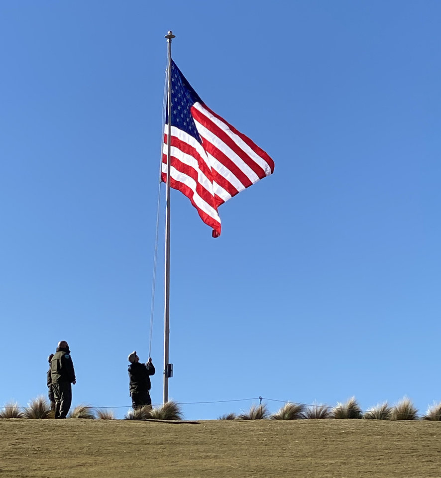 Photo - The flag and Park Rangers.  PROVIDED PHOTO