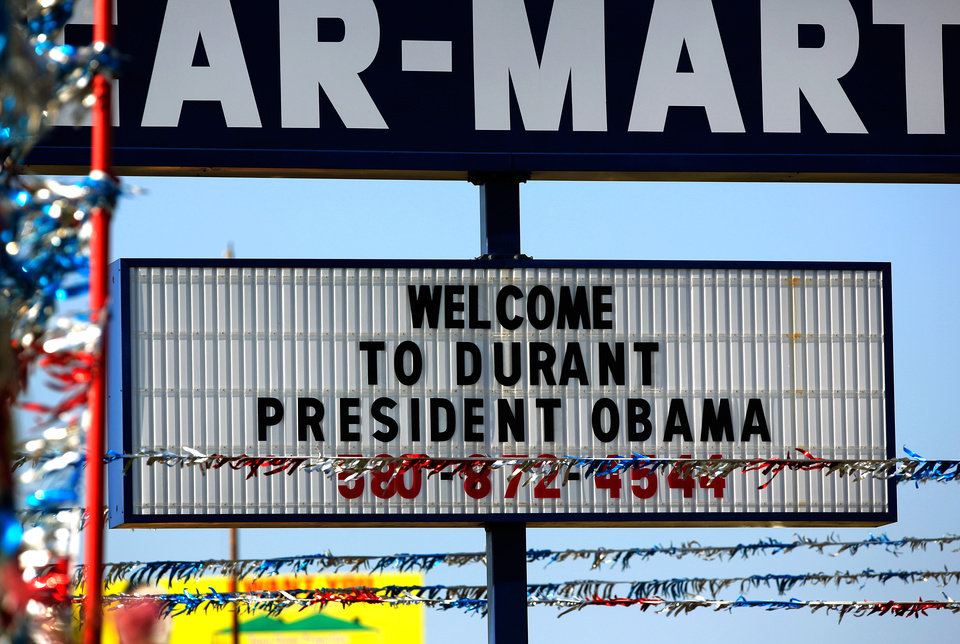 Photo - Many businesses in the southeastern community of Durant are anticipating the visit of President Obama this week and are posting various welcome signs in front of their buildings.  This sign is in front of a used car dealership on US Hiway 69. Obama will speak to selected guests on Wednesday, July 15, 2015, at Durant High School.  Photo by Jim Beckel, The Oklahoman.