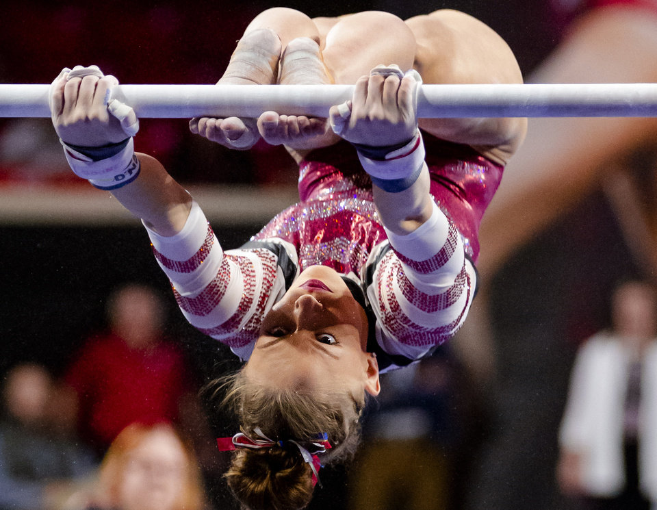 Photo - University of Oklahoma's Jade Degouveia competes in the bars during the women's gymnastics competition between the University of Oklahoma and Arkansas at the Lloyd Noble Center in Norman, Okla Monday, Jan. 20, 2020.   [Chris Landsberger/The Oklahoman]