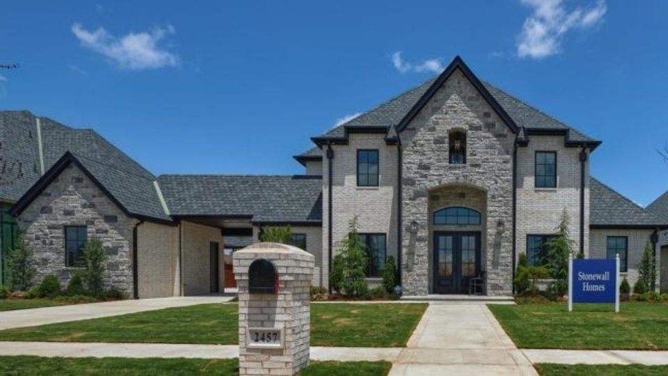 Photo -  Stonewall Homes built the festival home at 2457 SW 127 in Rivendell addition in south Oklahoma City. [PHOTO PROVIDED BY BASCO]