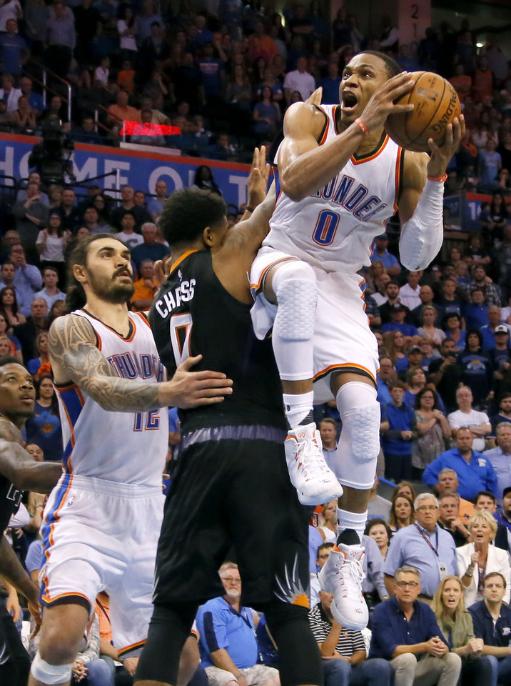 Photo - Oklahoma City's Russell Westbrook (0) makes a basket beside Phoenix's Marquese Chriss (0) to put the give the Thunder the lead late in overtime as Oklahoma City's Steven Adams (12) watches during an NBA basketball game between the Oklahoma City Thunder and the Phoenix Suns at Chesapeake Energy Arena in Oklahoma City, Friday, Oct. 28, 2016. Photo by Bryan Terry, The Oklahoman