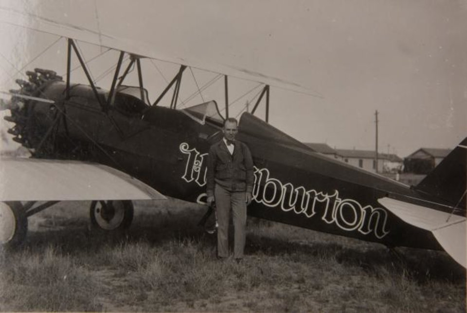 Photo -  A pilot stands next to a Halliburton aircraft the company used to get well samples quickly to its laboratory in Duncan for analysis. [PROVIDED BY STEPHENS COUNTY HISTORICAL SOCIETY]