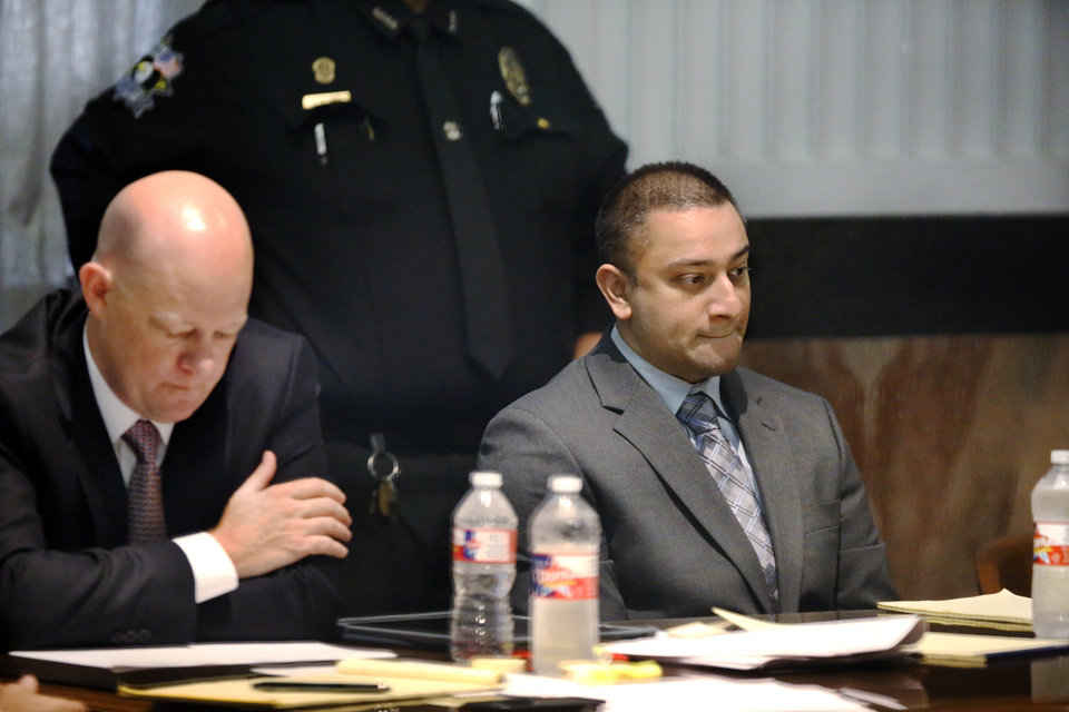 Photo - Murder defendant Bert Glen Franklin, right, and defense attorney Robert Grindy Truong's courtroom at the Oklahoma County courthouse. [Photo by Jim Beckel, The Oklahoman]