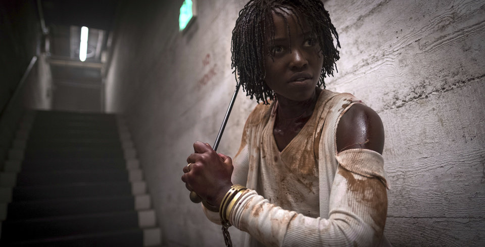"Photo - This image released by Universal Pictures shows Lupita Nyong'o in a scene from ""Us,"" written, produced and directed by Jordan Peele. (Claudette Barius/Universal Pictures via AP)"
