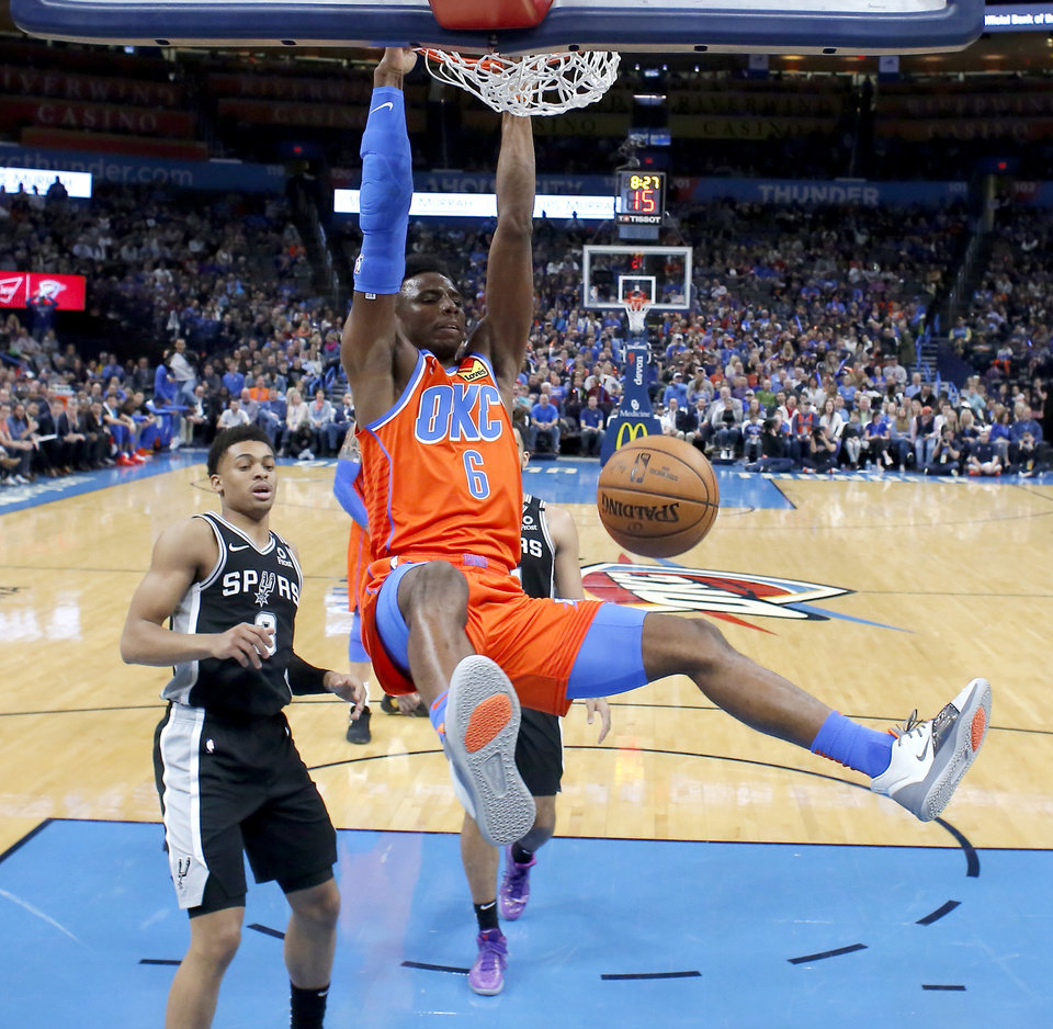 Photo - Oklahoma City's Hamidou Diallo (6) dunks the ball beside San Antonio's Keldon Johnson (3) during an NBA basketball game between the Oklahoma City Thunder and the San Antonio Spurs at Chesapeake Energy Arena in Oklahoma City, Sunday, Feb. 23, 2020. Oklahoma city won 131-103. [Bryan Terry/The Oklahoman]