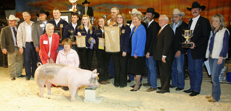 Photo - Mike Spradling, Ervin Mitchell, Brett Ramsey Donna Van Tungeln, Phyliss Holcomb, Roland Pederson, Charles Sloan, Tom Buchanon, Bob Drake, Billy Gibson, Ray Wulf and Lacey Dale-Culley with members of the Yukon FFA and Stephanie Payne with her Grand Champion barrow during the Sale of Champions of the Oklahoma Youth Expo at State Fair Arena in Oklahoma City, Thursday, March 20, 2008. BY MATT STRASEN, THE OKLAHOMAN ORG XMIT: KOD