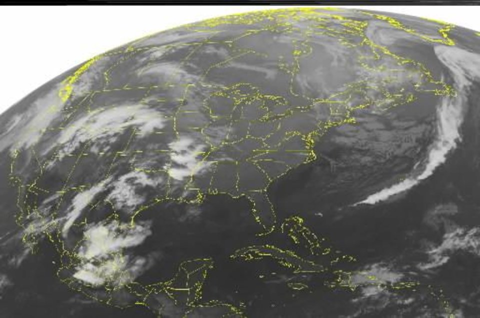 Photo - This NOAA satellite image taken Monday, May 10, 2010 at 1:45 a.m. EDT shows scattered clouds over the central U.S. as a storm system moves into the High Plains and a warm front lifts through central Texas. Gulf moisture interacts with these systems to produce scattered showers and thunderstorms over the Southern and Central Plains and the Lower and Mid-Mississippi Valley. (AP PHOTO/WEATHER UNDERGROUND)