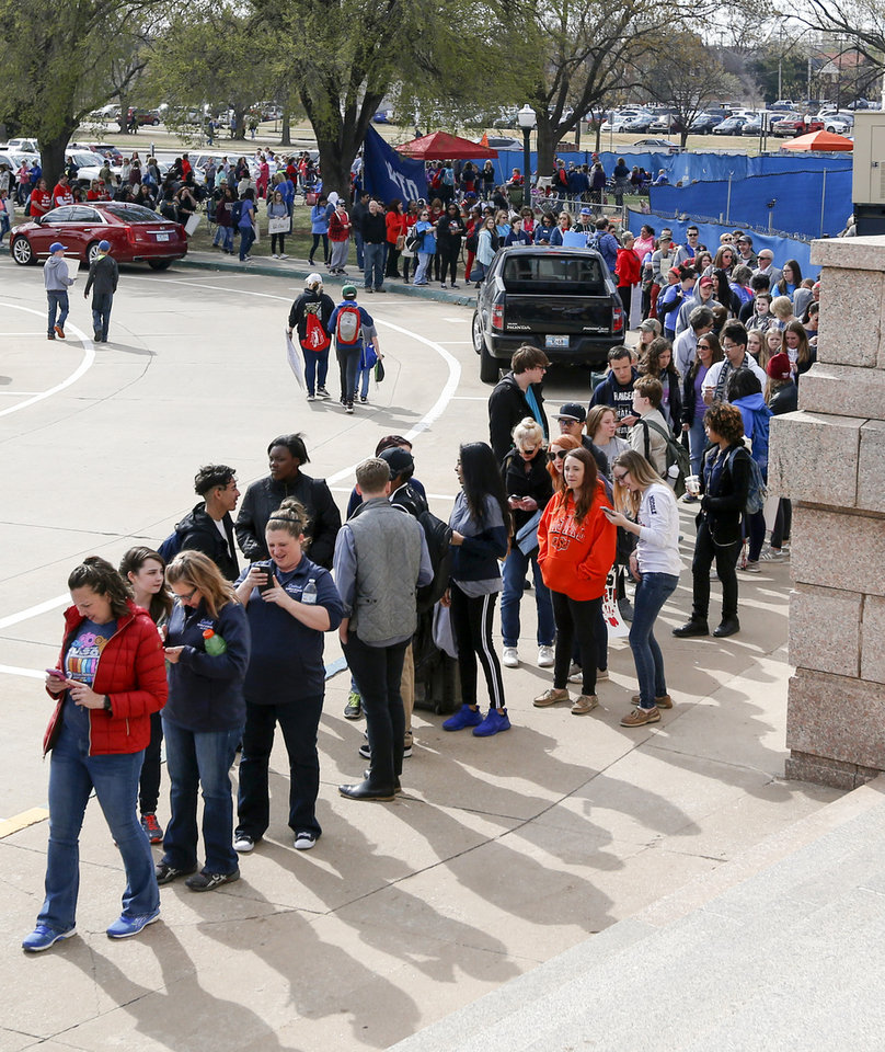 Photo - People wait in line to enter the state Capitol's east entrance during the eighth day of a walkout by Oklahoma teachers, in Oklahoma City, Monday, April 9, 2018. Photo by Nate Billings, The Oklahoman