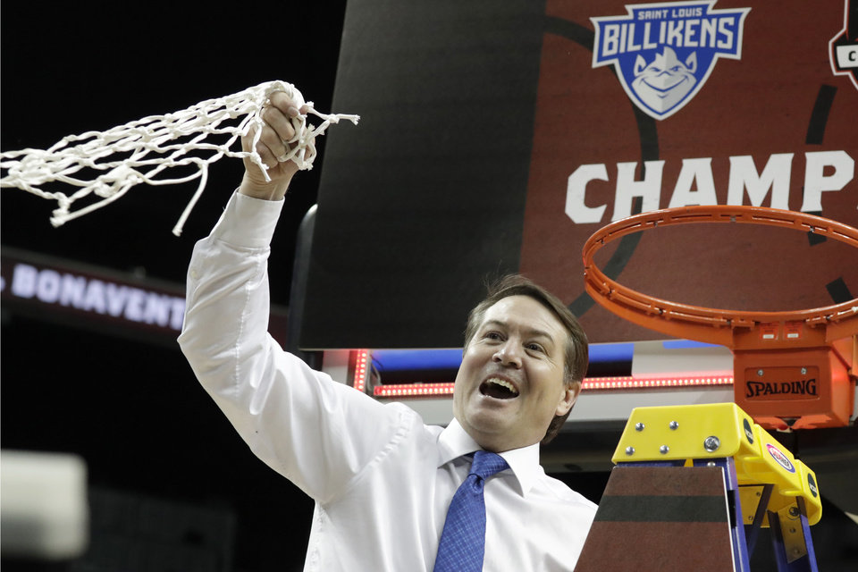 Photo - Saint Louis coach Travis Ford waves the net after Saint Louis defeated St. Bonaventure during an NCAA college basketball game in the final of the Atlantic 10 men's tournament Sunday, March 17, 2019, in New York. Saint Louis won 55-53. (AP Photo/Julio Cortez)