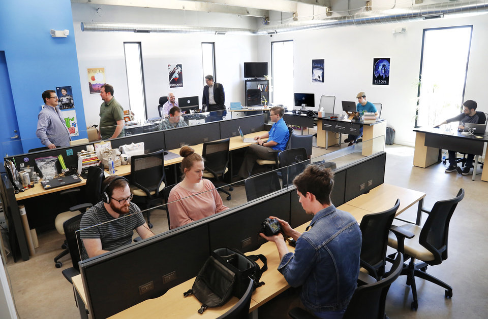 Photo -  Individuals work at the shared work space at StarSpace46, one of several locations where the North American Tech Tour will be making a stop in the Oklahoma City metro April 25-27. [Photo by Jim Beckel, The Oklahoman Archives]