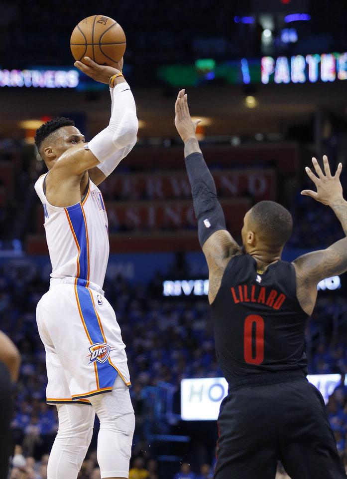 Photo - Oklahoma City's Russell Westbrook (0) shoots over Portland's Damian Lillard (0) during Game 4 in the first round of the NBA playoffs between the Portland Trail Blazers and the Oklahoma City Thunder at Chesapeake Energy Arena in Oklahoma City, Sunday, April 21, 2019.  Photo by Sarah Phipps, The Oklahoman