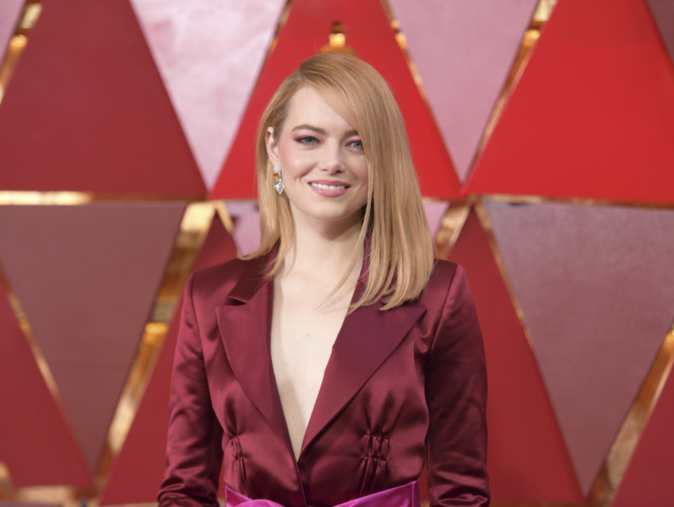 Photo - Emma Stone arrives at the Oscars on Sunday, March 4, 2018, at the Dolby Theatre in Los Angeles. (Photo by Richard Shotwell/Invision/AP)