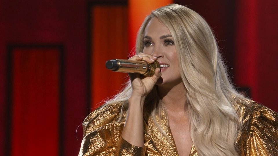 Photo - Carrie Underwood performs Wednesday on the 55th Academy of Country Music Awards. [Brent Harrington/CBS]