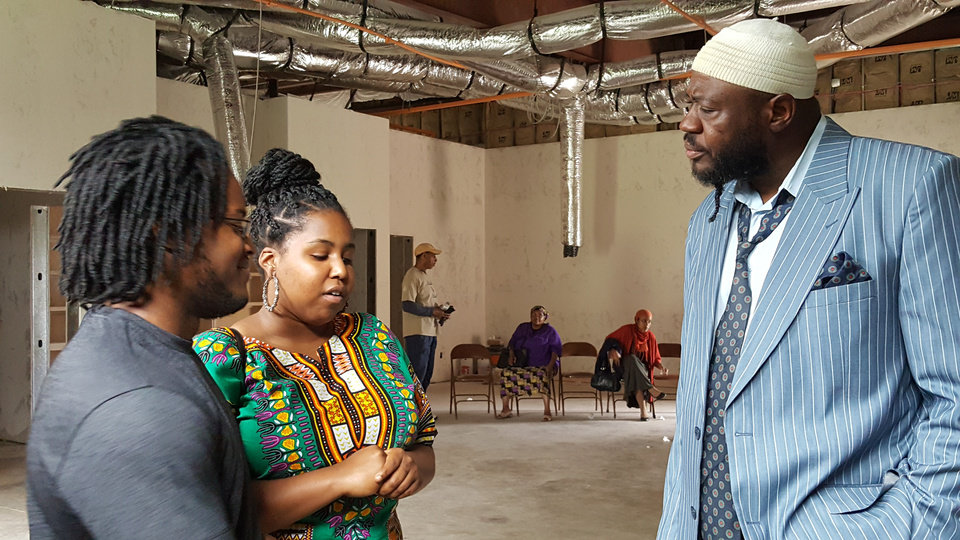 Photo -  After an interfaith youth tour presentation, Ismail Calhoun and Auziah Antwine talk with Arif Abdullah, imam of Masjid Mu'min, inside the northeast Oklahoma City mosque currently under construction. [Photo by Carla Hinton, The Oklahoman]
