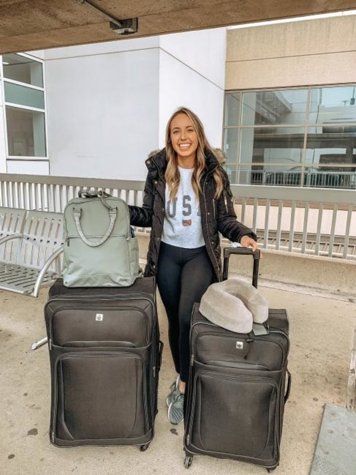 Photo -  Morgan Grizzle, a Norman native and Oklahoma City University alum, poses for a picture at the Dallas-Fort Worth Airport before heading to New York City to help beleagured hospitals as a volunteer nurse. [Photo provided]